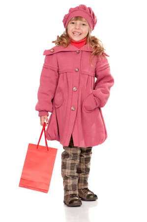 topcoat: Portrait of a pretty little girl with bag. Isolated on white background. Stock Photo