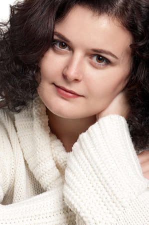 Portrait of a young woman in warm sweater with happy smile posing on white Stock Photo - 11328748