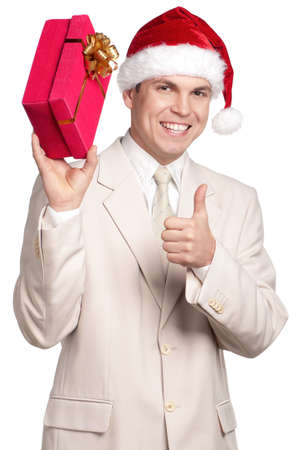 Portrait of handsome man in santa hat with gift box on white background photo