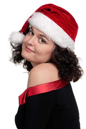Christmas girl wearing Santa hat over white background photo