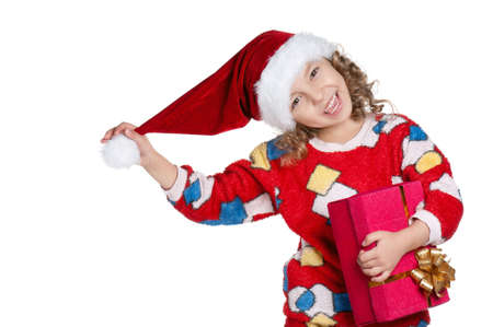 Portrait of happy Little girl in pajamas and santa hat with gift box over white background photo