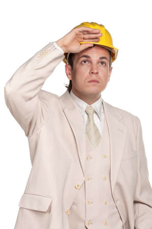 Portrait of handsome man with hard hat on white background photo