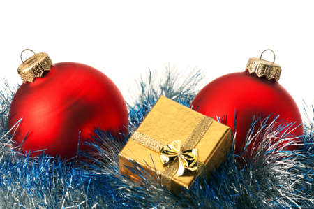 Christmas baubles and gift box on white background photo