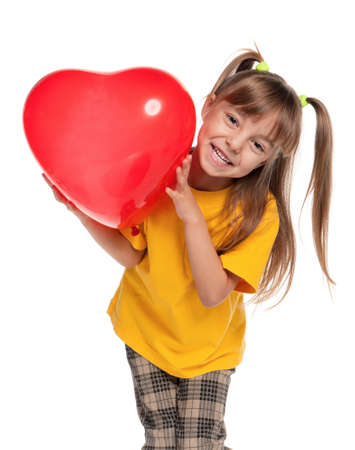 Portrait of little girl with red heart balloon over white background photo