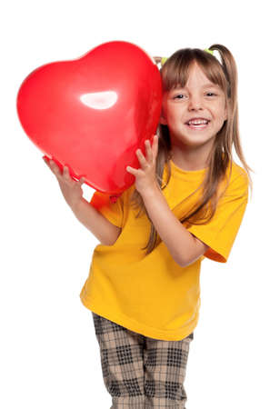 Portrait of little girl with red heart balloon over white background Stock Photo - 11479019