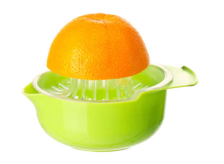 Plastic juicer for citrus with orange fruits on white background photo