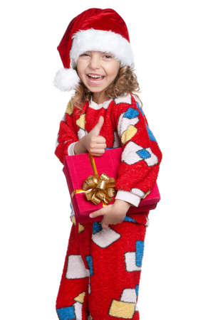Portrait of happy Little girl in pajamas and santa hat with gift box over white background Stock Photo - 11479007