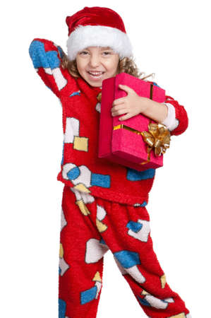 Portrait of happy Little girl in pajamas and santa hat with gift box over white background Stock Photo - 11479027