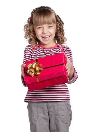 Portrait of happy little girl with gift box over white background photo
