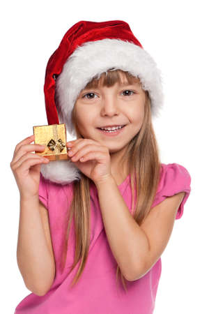 Portrait of happy little girl in santa hat with gift box over white background Stock Photo - 11479036