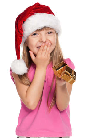 Portrait of happy little girl in santa hat with gift box over white background Stock Photo - 11479031