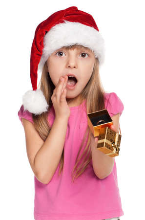 Portrait of happy little girl in santa hat with gift box over white background Stock Photo - 11479034