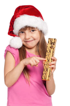 Portrait of happy little girl in santa hat with gift box over white background photo