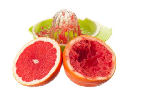 Glass of fresh grapefruit juice, juicer and grapefruit fruits on white background Stock Photo - 11633855