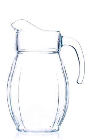Empty pitcher for juice or milk on white background photo