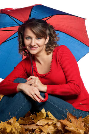 Portrait of a young woman holding an umbrella posing on white photo
