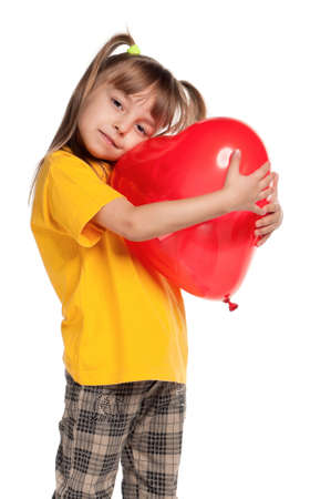 Portrait of little girl with red heart balloon over white background Stock Photo - 11866256