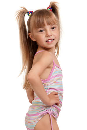 Little beautiful girl wearing pink swimsuit isolated on white background photo