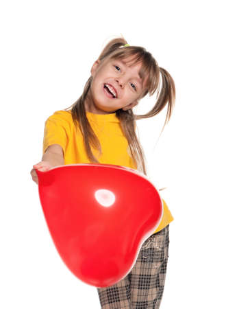 Portrait of little girl with red heart balloon over white background Stock Photo - 11866276