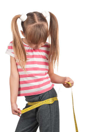 Portrait of little girl with yellow measure over white background Stock Photo - 11866341