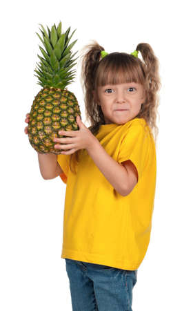 Portrait of surprised little girl with pineapple over white background Stock Photo - 11866312