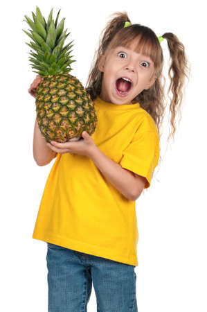 Portrait of surprised little girl with pineapple over white background photo