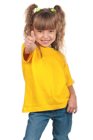Portrait of little girl giving you thumbs up over white background photo
