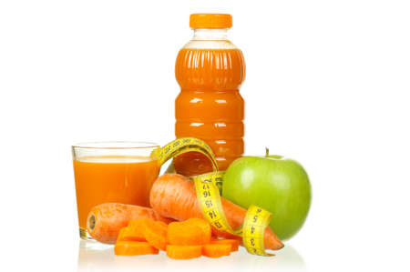 Fresh carrot and apple juice with a measure tape isolated on white background photo