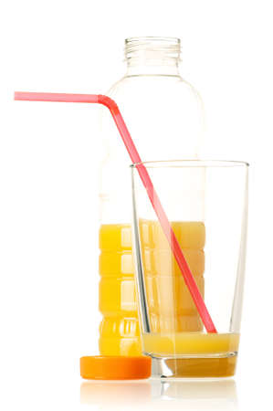 Orange juice in plastic bottle and glass on white background photo