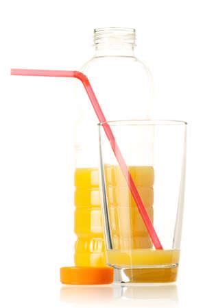 Orange juice in plastic bottle and glass on white background photo