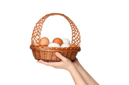 Basket with eggs in woman hand isolated on white background Stock Photo - 12012415