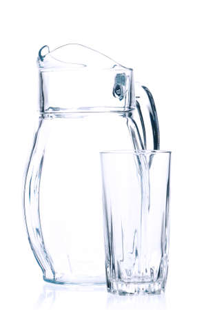 Empty pitcher for juice or milk and glass on white background photo
