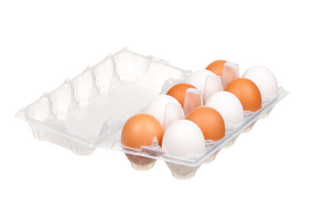 Brown and white eggs in the plastic box over white background photo