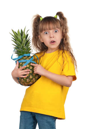 Portrait of surprised little girl with pineapple and blue measure over white background Stock Photo - 12014397