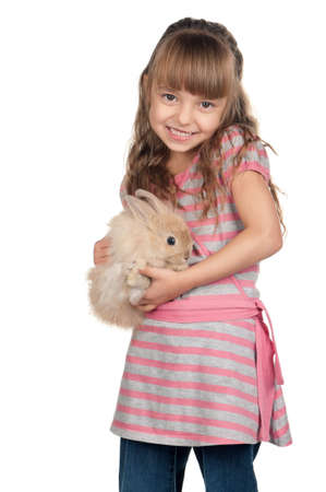 rabbit ears: Easter concept image. Portrait of happy little girl with adorable rabbit over white background. Stock Photo