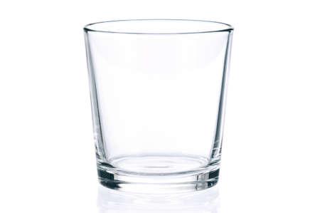 Empty glass for water, juice or milk on white background photo