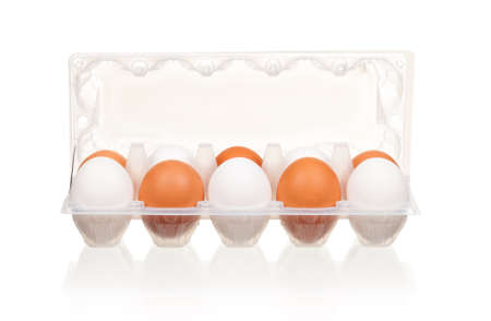 Brown and white eggs in the plastic box over white background Stock Photo - 12075436