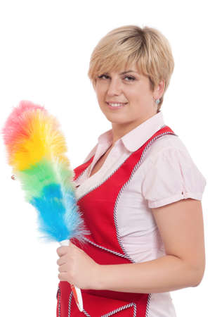 Happy young housewife holding duster - isolated on white background