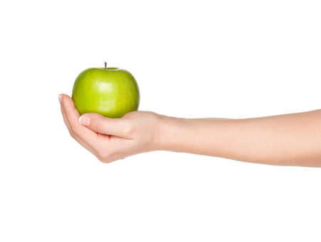 feminine hands: Woman hand with green apple isolated on white background Stock Photo