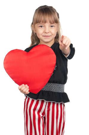 Portrait of little girl holding red heart over white background photo