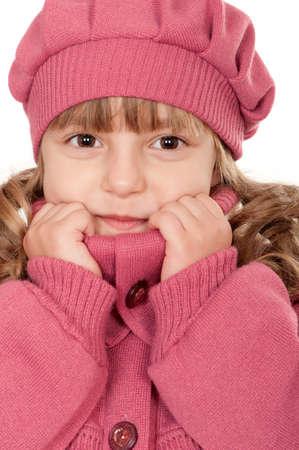 Portrait of a pretty little girl in sweater on white background photo