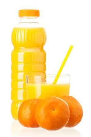 Mandarin juice in plastic bottle and mandarin fruits on white background photo