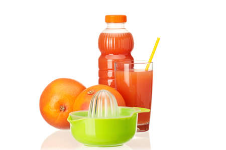 Grapefruit juice in plastic bottle and grapefruit fruits on white background photo