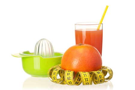 Fresh grapefruit juice with measure tape and grapefruit fruits on white background Stock Photo - 12325850