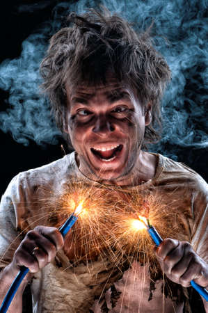 electric shock: Portrait of crazy electrician over black background Stock Photo