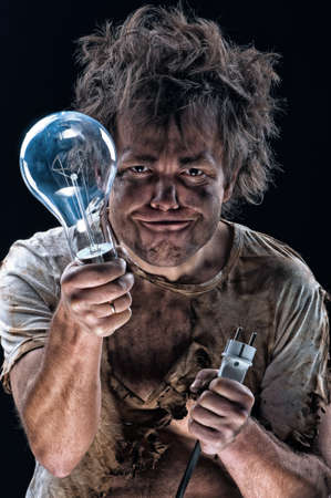electrocute: Portrait of funny electrician over black background