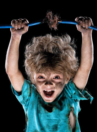 Portrait of crazy little electrician over black background Stock Photo - 12325987