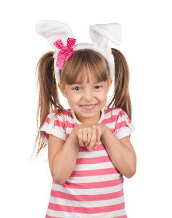 Easter concept image. Portrait of happy little girl with bunny ears over white background. photo