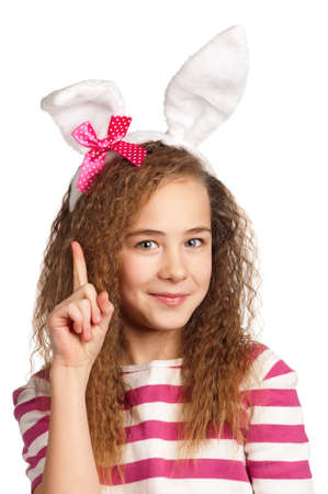 Portrait of happy girl with bunny ears isolated on white background photo
