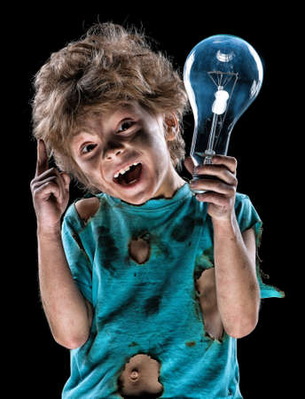 Portrait of funny little electrician over black background photo